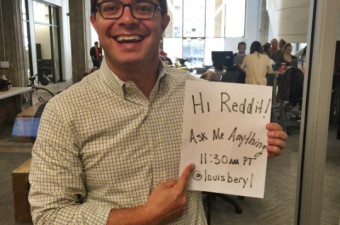 Louis Beryl holding reddit sign